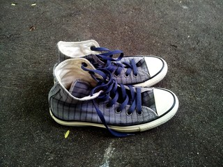 High Angle View Of Abandoned Canvas Shoe On Road Wall mural