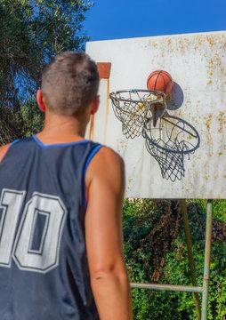 Basketball player on a backyard basketball court