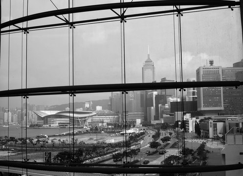 Modern Buildings In City Against Sky Seen Through Glass Window