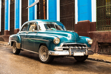 old blue vintage classic american car in the street of havana cuba