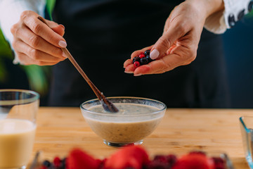 Superfoods - Making oatmeal with Oats, Soy Milk and Berries