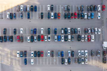 Open air big parking for residents of the area, top aerial view from high Wall mural