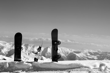 Fototapete - Three snowboards in snowdrift near snowy off-piste slope in sun winter day