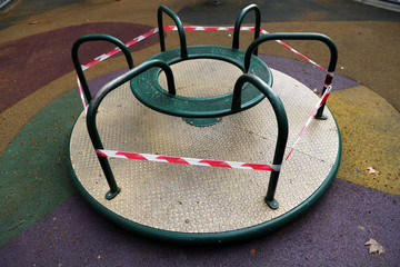A children's merry-go-round is seen cordoned off during lockdown amid the coronavirus disease (COVID-19) outbreak, in Madrid
