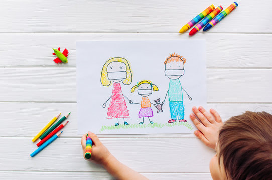 Little girl drawing a picture of family in face masks on white background