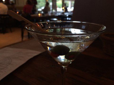 Close-up Of Fresh Drink In Martini Glass On Table At Restaurant