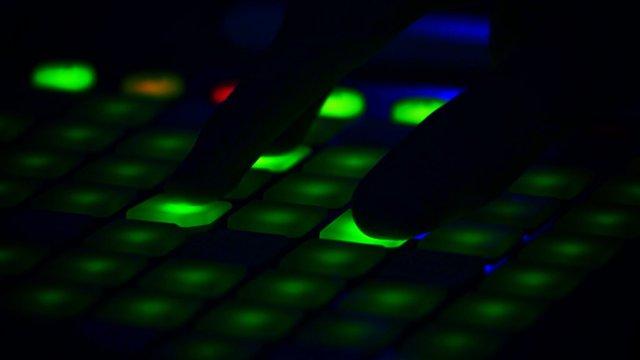 Cropped Image Of Dj Playing Illuminated Launchpad