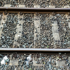 High Angle View Of Railroad Tracks And Gravel