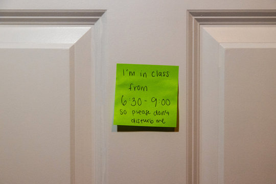 Note on bedroom door indicating home school class is in session