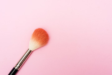 Goat hair brush for makeup and blush is on a pink background