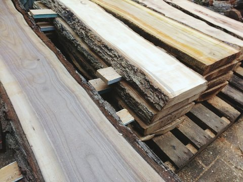 High Angle View Of Stacked Wooden Slabs