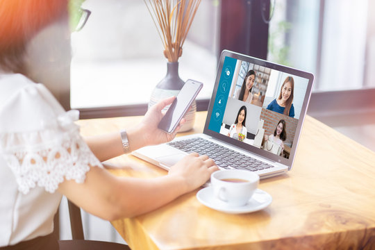 Asian businesswoman talking colleagues about plan life in video conference. Multiethnic business team laptop online meeting in video call.smart working from home, quarantine from coronavirus covid-19