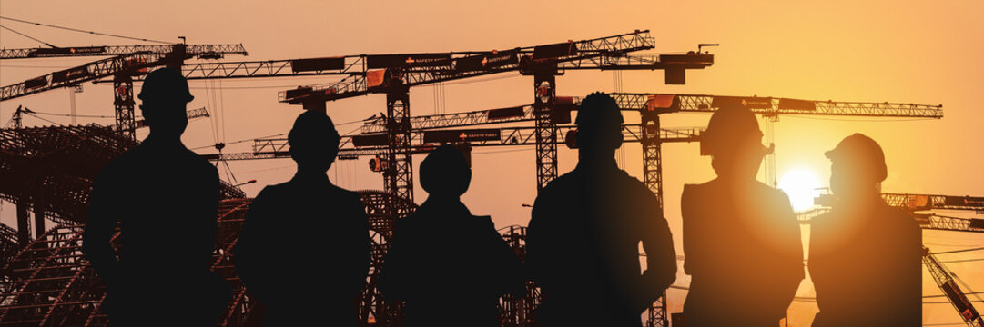 multiexposure construction industrial background of shadow of construction project engineers and workers overlay with silhouette construction project site background