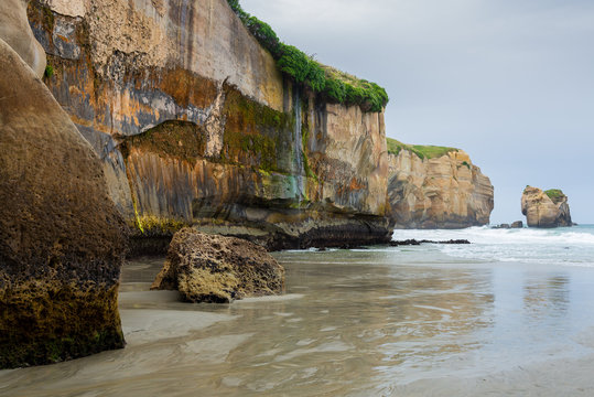 Dramatic Tunnel Beach carved into the cliffs, Dunedin, New Zealand
