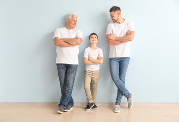 Man with his father and son near color wall