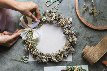 Woman making a floral wreath