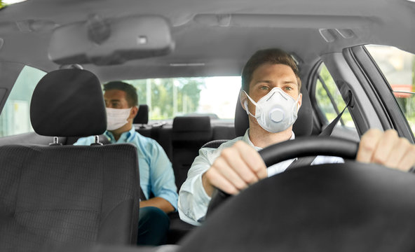 health care, safety and pandemic concept - male taxi driver driving car and passenger wearing face protective mask for protection from virus disease