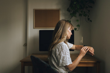 Woman sitting in front of a computer during coronavirus quarantine