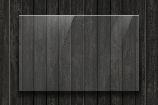 Glass transparent plate on a dark wooden background