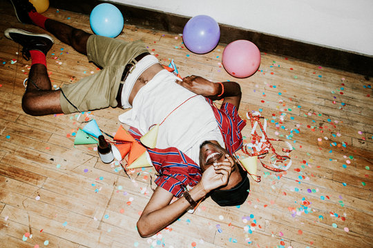 Happy man on the floor at a party