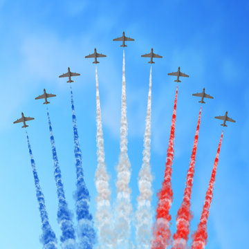 Vector illustration with nine planes and trails in blue white and red colors of the flag of France or USA isolated on sky background. USA Independence Day or France Bastille Day greeting card.