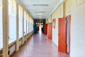 An empty school corridor stretching into the future. The concept of holidays, quarantine, evacuation