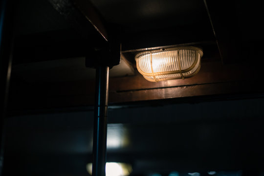 Low Angle View Of Illuminated Light Fixture On Ceiling