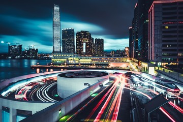 Beautiful view of Honk Kong city with roads and long exposure lights at night Wall mural