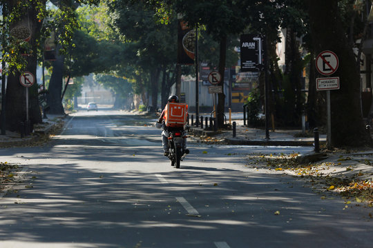 Jesus Villamizar rides his motorcycle on a delivery trip during a nationwide quarantine due to coronavirus disease (COVID-19) outbreak in Caracas