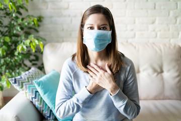 Woman sending love during covid19 pandemic