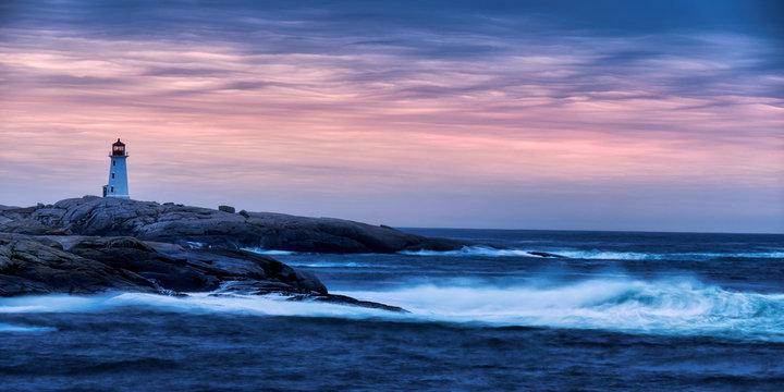 lighthouse on the coast at sunrise