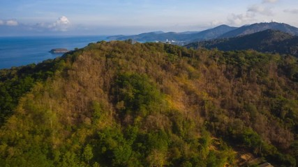 Wall Mural - Aerial hyperlapse of the tropical coastline with beaches and green lush forest. Phuket island, Thailand