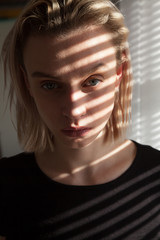 Fototapeta Portrait of a beautiful fashionable blonde woman in black clothes