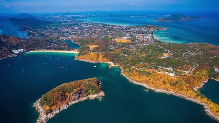 Fototapete - Aerial hyperlapse of Phuket island. Flight over Rawai district - southernmost area of the island. Thailand