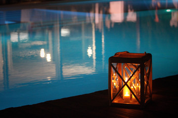 night swimming pool and candles