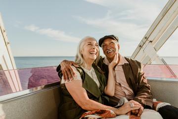 Happy senior couple on a Ferris wheel