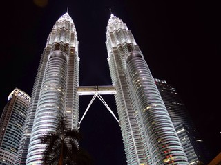 Wall Murals Kuala Lumpur Low Angle View Of Illuminated Tower At Night