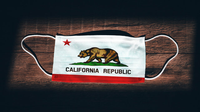 California Flag. Coronavirus Covid 19 in U.S. State. Medical mask isolate on a black background. Face and mouth masks for protection against airborne infections in USA, America