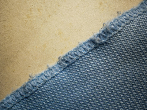 Blue trimmed fabric on gray background