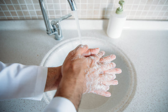 Man washing hands properly with soap to be protected for Coronavirus 2019-nCoV pandemic epidemic infection. Doctor shows how to wash hands properly.