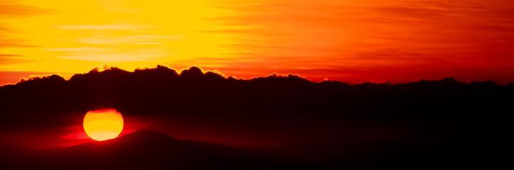 Foto auf AluDibond Rotglühen Silhouette Of Landscape At Sunset