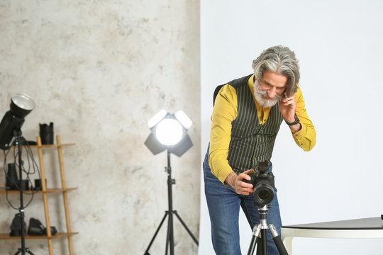 Senior photographer working in studio
