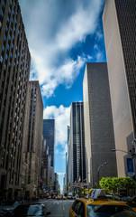 Road Amidst Buildings In City - fototapety na wymiar