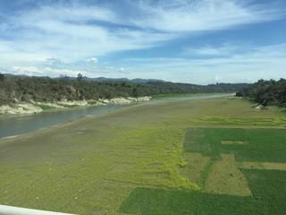 Fotobehang Golf Grassy Field Next To River