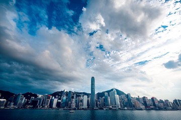 Fototapete - Panorama of Hong Kong City skyline from across Victoria Harbor; with Sunlight effect