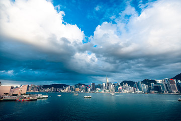 Fotomurales - Panorama of Hong Kong City skyline from across Victoria Harbor; with Sunlight effect