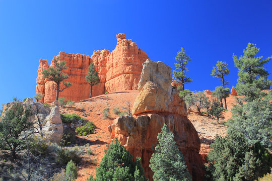 Low Angle View Of Rock Formation Against Clear Blue Sky At Bryce Canyon National Park