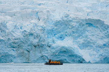 Boat in front of Giant Iceberg
