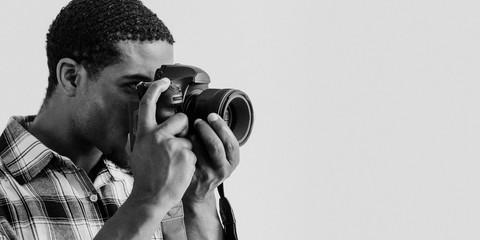 Black photographer at a shoot Fotobehang