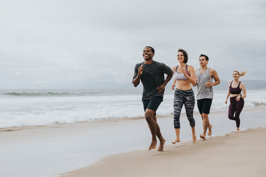 Fit people jogging on the beach